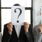 Five people with question marks in front of faces